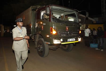 Police track carrying the bodies of passengers who were killed during an ambush on a Nairobi-bound bus outside Mandera town, leaves the Wilson airport in the capital Nairobi