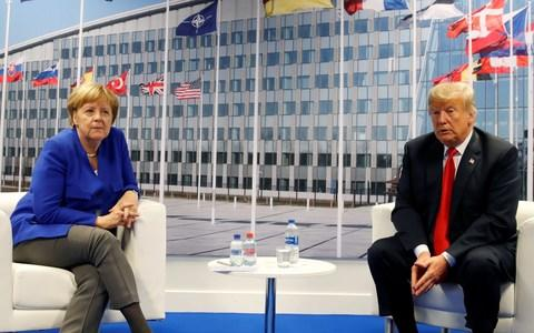 Keeping their distance; Angela Merkel meets with Donald Trump during the Nato summit in Brussels - Credit: REUTERS