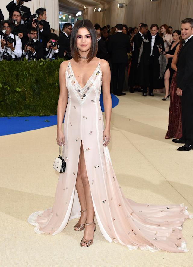 <p>As a brand ambassador for Coach, Selena Gomez was obviously dressed by the brand. Stuart Vevers, the company's creative director, made the pop star a custom white gown with sequin clusters and lace trim.(Photo by John Shearer/Getty Images) </p>