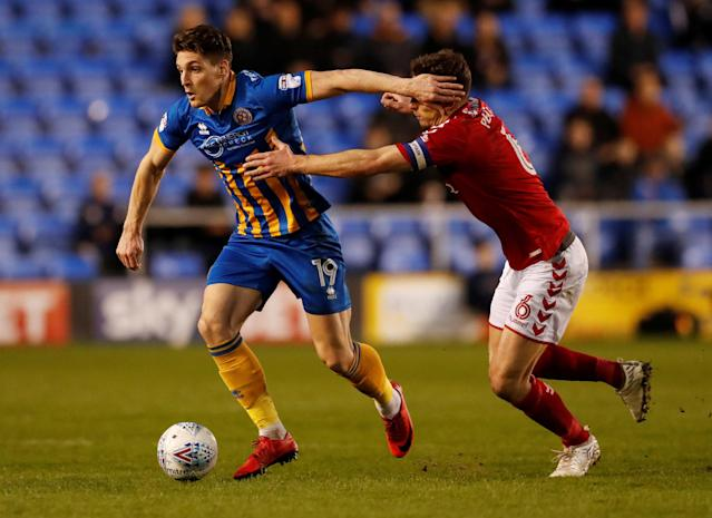 "Soccer Football - League One - Shrewsbury Town vs Charlton Athletic - Montgomery Waters Meadow, Shrewsbury, Britain - April 17, 2018 Shrewsbury Town's Sam Jones in action with Charlton's Jason Pearce Action Images/Andrew Boyers EDITORIAL USE ONLY. No use with unauthorized audio, video, data, fixture lists, club/league logos or ""live"" services. Online in-match use limited to 75 images, no video emulation. No use in betting, games or single club/league/player publications. Please contact your account representative for further details."