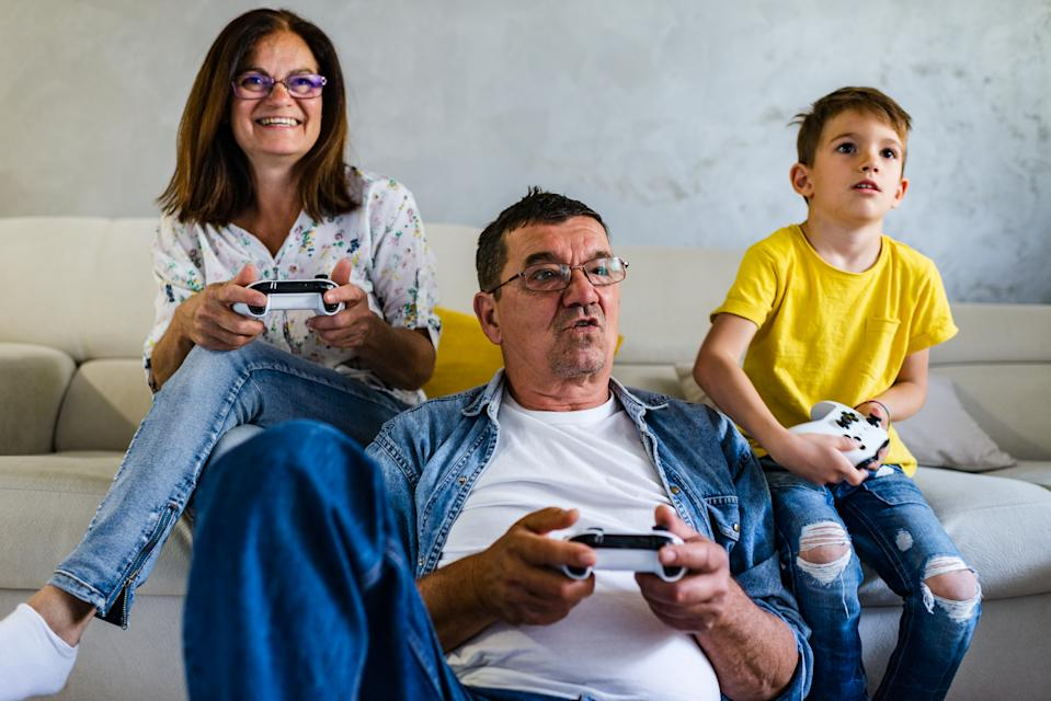 Family screen time. Playing video games and spending time together during COVID-19 isolation.
