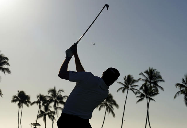 Matt Kuchar hits from the 11th tee during the second round of the Sony Open PGA Tour golf event, Friday, Jan. 11, 2019, at Waialae Country Club in Honolulu. (AP Photo/Matt York)