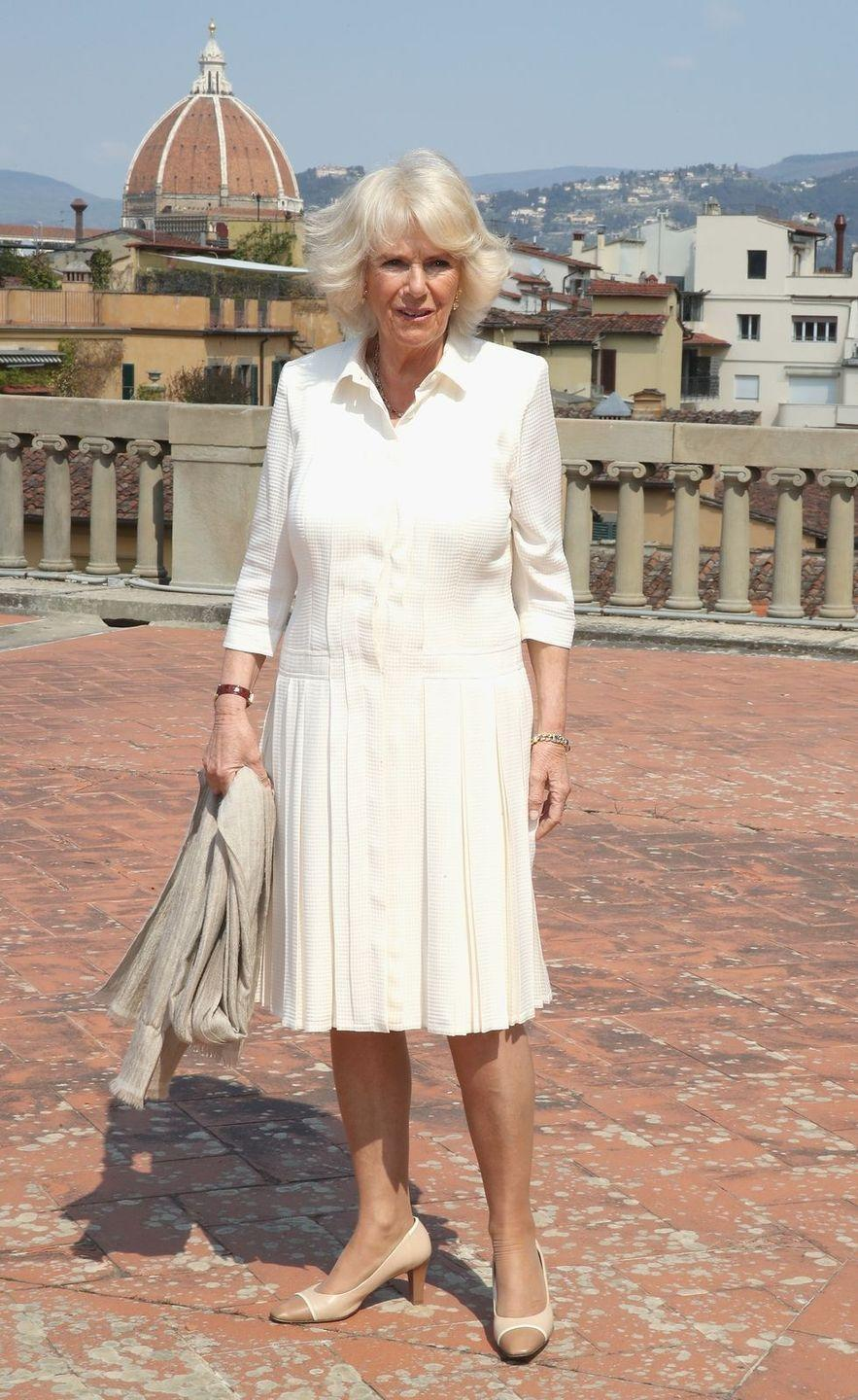 <p>In Florence, Italy Camilla posed in Palazzo Pitti wearing this dropwaist buttercream dress with two-toned pumps for an event for the Italian Wool Industry.</p>