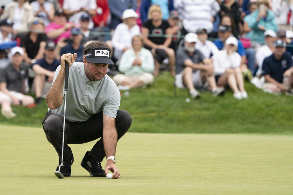 Bubba Watson lines up his putt on the ninth green during the second round of the Travelers Championship golf tournament at TPC River Highlands, Friday, June 25, 2021, in Cromwell, Conn. (AP Photo/John Minchillo)