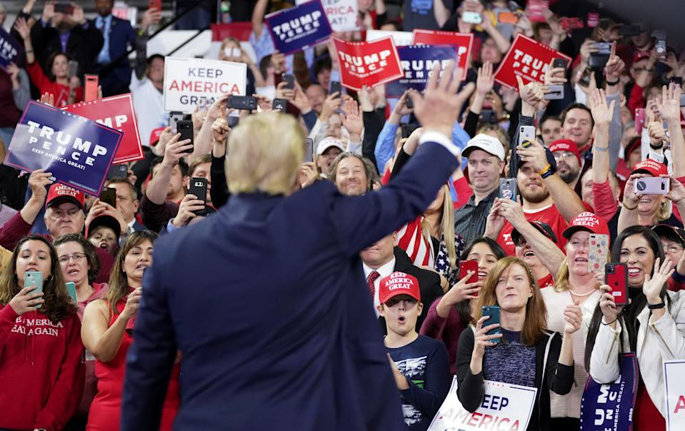 U.S. President Donald Trump waves to supporters during a campaign rally in Milwaukee, Wisconsin, U.S., January 14, 2020. REUTERS/Kevin Lamarque