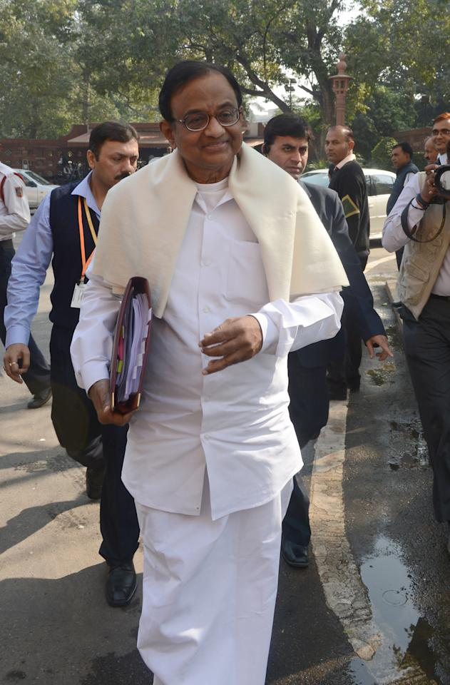 Indian Finance Minister P. Chidambaram arrives at Parliament as unseen opposition MPs protest against the Congress-led United Progressive Alliance (UPA) government on Foreign Direct Investment (FDI) at the Winter Session of Parliament in New Delhi  on November 22, 2012. India's shaky government and the opposition locked horns on Thursday as parliament re-opened for a crucial session that will see a recent string of pro-market reforms being hotly contested. AFP PHOTO/RAVEENDRAN