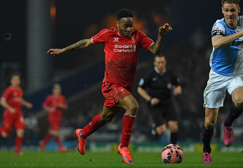 Liverpool's English midfielder Raheem Sterling (L) runs with the ball during the English FA Cup quarter-final replay football match between Blackburn Rovers and Liverpool in Blackburn, England on April 8, 2015 (AFP Photo/Paul Ellis)