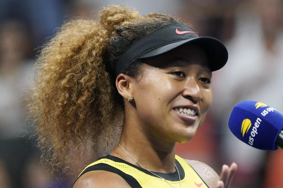 Naomi Osaka, of Japan, speaks to the crowd after beating Marie Bouzkova, of the Czech Republic, during the first round of the US Open tennis championships, Monday, Aug. 30, 2021, in New York. (AP Photo/Elise Amendola)