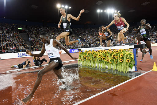 Kenya's Conseslus Kiprutu competes without a shoes on his way to win the men's 3000m steeplechase race during the Weltklasse IAAF Diamond League international athletics meeting in the Letzigrund stadium in Zurich, Switzerland, Thursday, August 30, 2018. (Jeah-Christophe Bott/Keystone via AP)