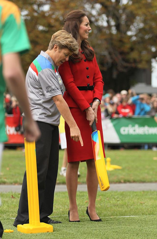 CHRISTCHURCH, NEW ZEALAND - APRIL 14: Catherine, Duchess of Cambridge reacts to being shown how to bat by Debbie Hockley, ICC Hall of Fame before a game of cricket during the countdown to the 2015 ICC Cricket World Cup at Hagley Oval on April 14, 2014 in Christchurch, New Zealand. The Royal couple are currently in New Zealand and touring the country until Wednesday, when they then head to Australia. Today the Royals visit the redevelopments at Hagley Oval, the venue for ICC Cricket World Cup 2015 matches in Christchurch. (Photo by Joseph Johnson/Getty Images for ICC Cricket World Cup)