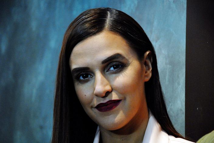 Indian Bollywood actress Neha Dhupia, the host for the Colors Infinity TV Serial Vogue BFFs, looks on while on set in Mumbai on January 2, 2018. (Photo by Sujit Jaiswal / AFP) (Photo credit should read SUJIT JAISWAL/AFP/Getty Images)