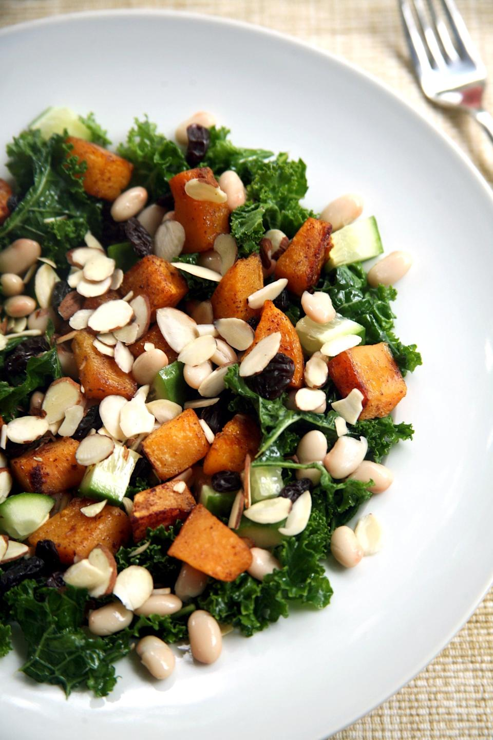 """<p>Massaged kale is topped with warm maple-cinnamon roasted butternut squash, white beans for protein, cucumbers and almonds for a satisfying crunch, and raisins for a little added sweetness. </p> <p><strong>Get the recipe:</strong> <a href=""""https://www.popsugar.com/fitness/Maple-Butternut-Squash-Kale-Salad-42552336"""" class=""""link rapid-noclick-resp"""" rel=""""nofollow noopener"""" target=""""_blank"""" data-ylk=""""slk:maple-roasted butternut squash, kale, and white bean salad"""">maple-roasted butternut squash, kale, and white bean salad</a></p>"""