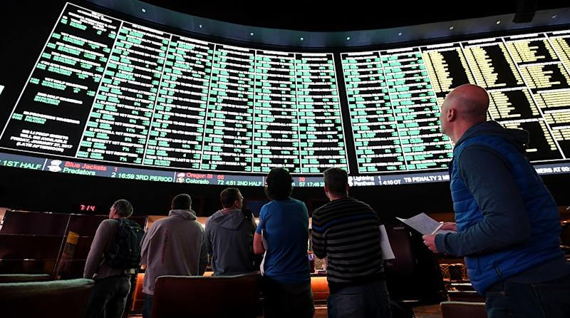 MLB says it will support gambling legislation but wants to protect the integrity of the game. (AP)
