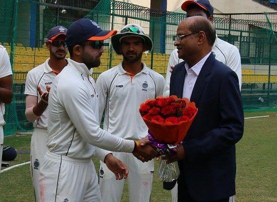 Ajay Rohera receiving the bouquet after his grand knock