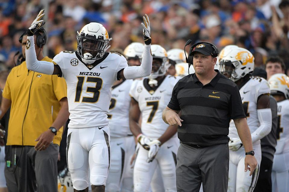 Missouri wide receiver Kam Scott (13) and head coach Barry Odom react on the sideline after a touchdown reception by wide receiver Emanuel Hall during the second half of an NCAA college football game against Florida Saturday, Nov. 3, 2018, in Gainesville, Fla. Missouri won 38-17. (AP Photo/Phelan M. Ebenhack)
