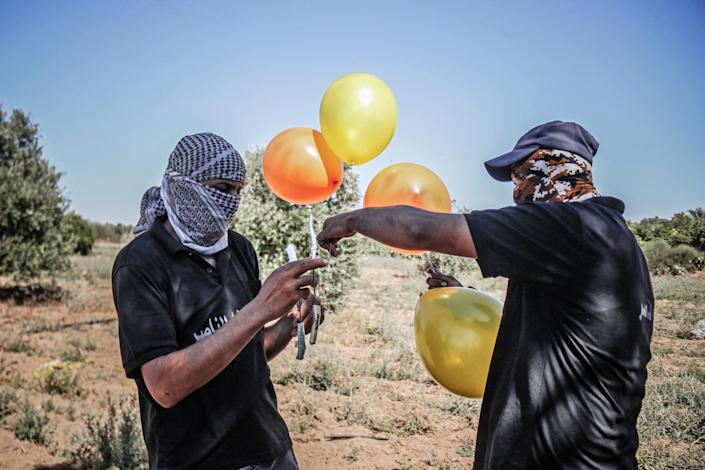 Image: Cross-Border Hostilities Reignite With Incendiary Balloons And Airstrikes (Fatima Shbair / Getty Images)