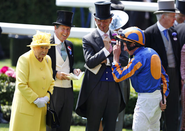 Britain Horse Racing - Royal Ascot - Ascot Racecourse - June 21, 2017 Britain's Queen Elizabeth II with jockey Ryan Moore before the 2.30 Jersey Stakes REUTERS/Eddie Keogh Livepic