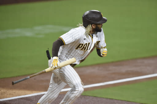 San Diego Padres' Fernando Tatis Jr. (23) hits a double during the third inning of a baseball game against the Seattle Mariners, Saturday, Sept. 19, 2020, in San Diego. (AP Photo/Denis Poroy)