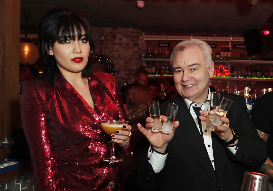 LONDON, ENGLAND - DECEMBER 16: Daisy Lowe (L) and Eamonn Holmes at the celebration of Absolut Crackers on December 16, 2019 in London, England. (Photo by David M. Benett/Dave Benett/Getty Images for Absolut Vodka UK)
