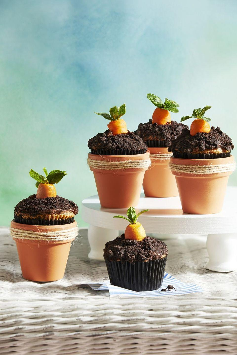 "<p>Top carrot cupcakes with orange cream cheese frosting and a mint sprig to make these fall harvest-inspired sweets. Place them in mini terra-cotta pots for the cutest-ever dessert!</p><p><em><a href=""https://www.countryliving.com/food-drinks/a30876020/carrot-patch-cupcakes-recipe/"" rel=""nofollow noopener"" target=""_blank"" data-ylk=""slk:Get the recipe from Country Living »"" class=""link rapid-noclick-resp"">Get the recipe from Country Living »</a></em></p>"