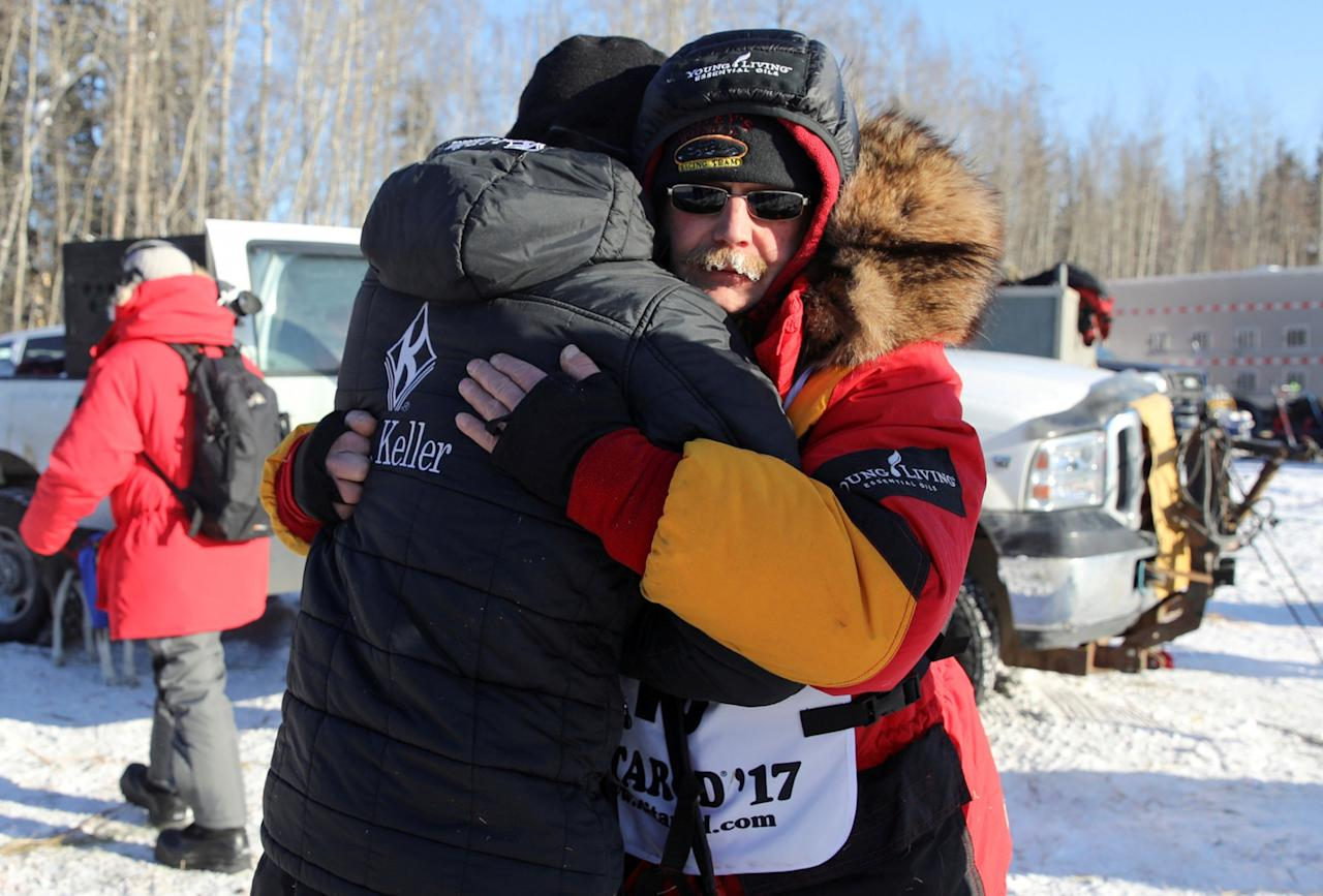 <p>Mitch Seavey hugs son, Dallas Seavey (four-times champion) before they both race at the official restart of the Iditarod, a nearly 1,000 mile (1,610 km) sled dog race across the Alaskan wilderness, in Fairbanks, Alaska, U.S. March 6, 2017. REUTERS/Nathaniel Wilder/File Photo </p>