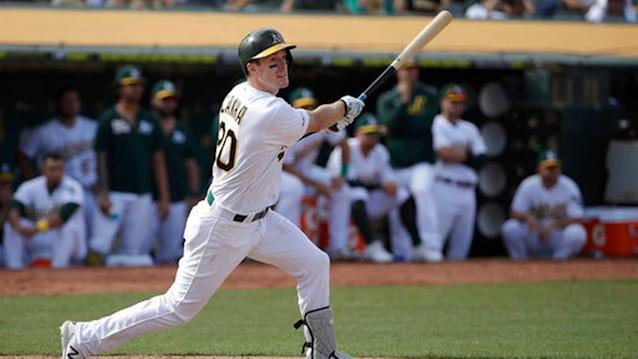 Canha hit in 11th, A's edge KC 1-0 to hold wild card lead