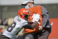 Cleveland Browns linebacker Jeremiah Owusu-Koramoah, left, runs a drill during an NFL football rookie minicamp at the team's training camp facility, Friday, May 14, 2021, in Berea, Ohio. (AP Photo/Tony Dejak)