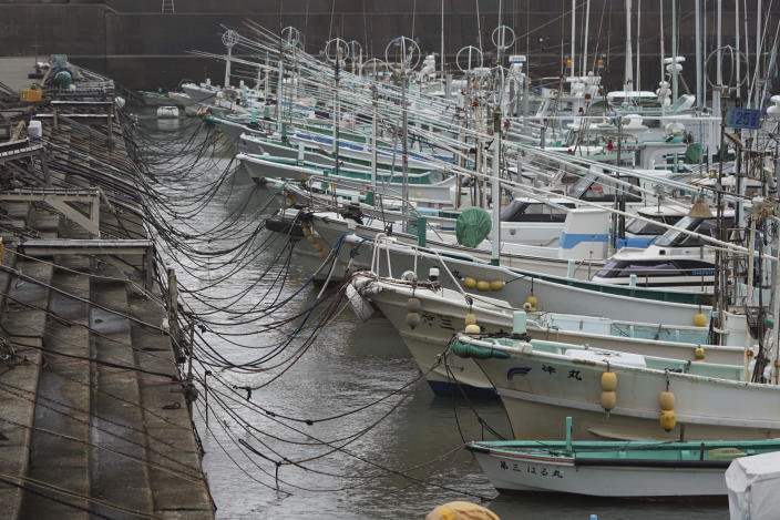 Fishing boats are anchored at a port as Typhoon Hagibis approaches in town of Kiho, Mie Prefecture, Japan Friday, Oct. 11, 2019. A powerful typhoon is advancing toward the Tokyo area, where torrential rains are expected this weekend. (AP Photo/Toru Hanai)