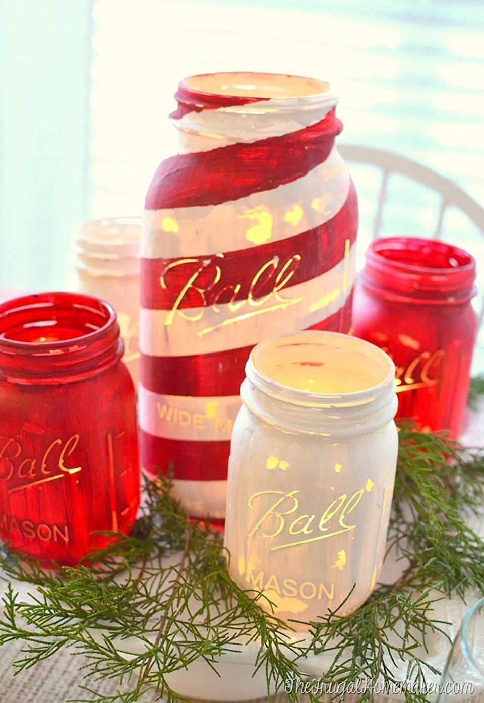 """<p>The chalky paint gives this Mason jar craft a vintage look. </p><p><strong>Get the tutorial at <a href=""""http://thefrugalhomemaker.com/2014/12/10/chalky-painted-mason-jars-and-christmas-tablescape-americana-decor-chalky-finish-paint-giveaway/"""" rel=""""nofollow noopener"""" target=""""_blank"""" data-ylk=""""slk:The Frugal Homemaker"""" class=""""link rapid-noclick-resp"""">The Frugal Homemaker</a>. </strong></p><p><a class=""""link rapid-noclick-resp"""" href=""""https://www.amazon.com/FolkArt-Pl34150-Decor-Adirondack-Multicolor/dp/B00JRR21FY/?tag=syn-yahoo-20&ascsubtag=%5Bartid%7C10050.g.2132%5Bsrc%7Cyahoo-us"""" rel=""""nofollow noopener"""" target=""""_blank"""" data-ylk=""""slk:SHOP CHALK PAINT"""">SHOP CHALK PAINT</a></p>"""