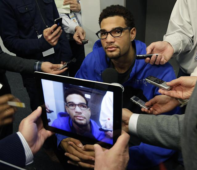 Kentucky forward Willie Cauley-Stein is interviewed in the locker room before practice for the NCAA Final Four tournament college basketball championship game Sunday, April 6, 2014, in Arlington, Texas. Kentucky plays Connecticut in the championship game on Monday, April 7. 2014. (AP Photo/Eric Gay)