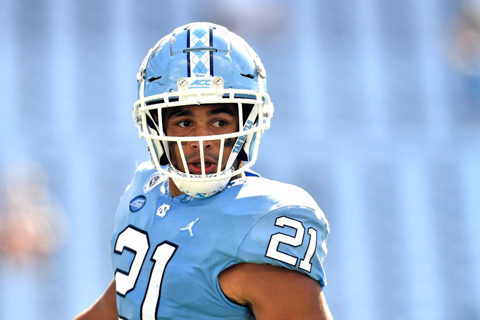 CHAPEL HILL, NORTH CAROLINA - OCTOBER 24: Chazz Surratt #21 of the North Carolina Tar Heels surveys the field during their game against the North Carolina State Wolfpack at Kenan Stadium on October 24, 2020 in Chapel Hill, North Carolina. The Tar Heels won 48-21. (Photo by Grant Halverson/Getty Images)