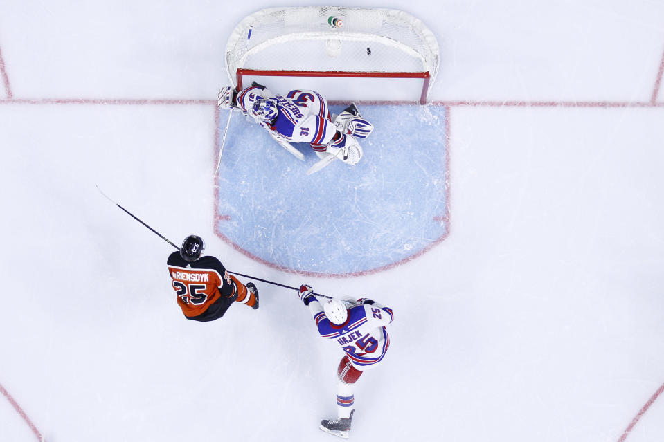 Philadelphia Flyers' James van Riemsdyk, left, scores a goal past New York Rangers' Igor Shesterkin, center, and Libor Hajek during the second period of an NHL hockey game, Wednesday, Feb. 24, 2021, in Philadelphia. (AP Photo/Matt Slocum)