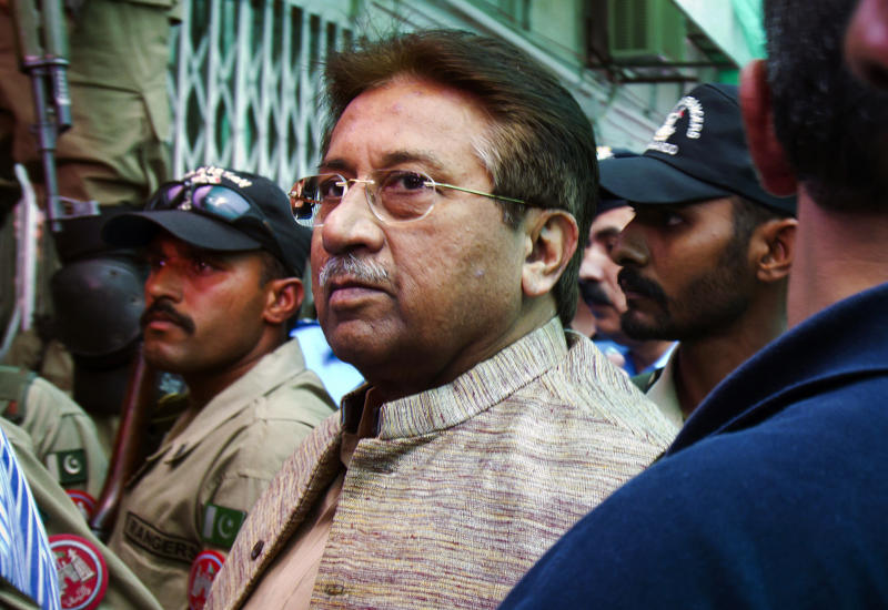 FILE - In this April 20, 2013, file photo, Pakistan's former President and military ruler Pervez Musharraf arrives at an anti-terrorism court in Islamabad, Pakistan. A Pakistani court Tuesday indicted Musharraf on murder charges in connection with the 2007 assassination of iconic Pakistani Prime Minister Benazir Bhutto, deepening the fall of a once-powerful figure who returned to the country this year in an effort to take part in elections. (AP Photo/Anjum Naveed, File)