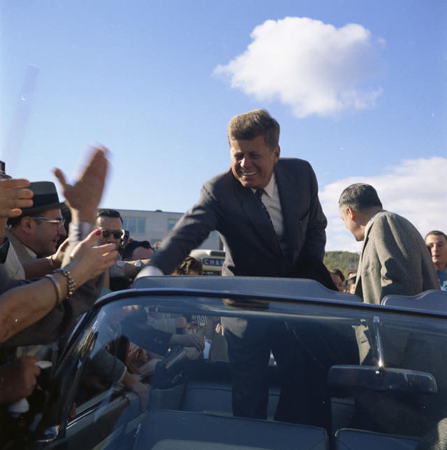 <p>Sen. John F. Kennedy greets a roadside crowd while campaigning in Indiana on Oct. 5, 1960. (Photo: Sven Walnum/Sven Walnum Photograph Collection/John F. Kennedy Presidential Library and Museum) </p>