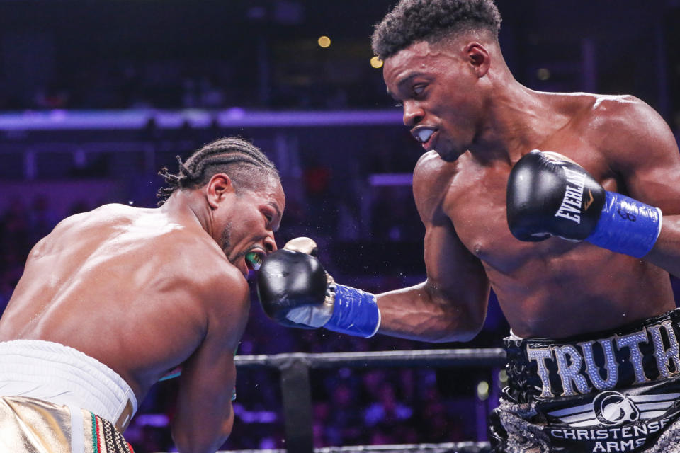 Errol Spence Jr. , right, lands a punch against Shawn Porter during the WBC & IBF World Welterweight Championship boxing match Saturday, Sept. 28, 2019, in Los Angeles. (AP Photo/Ringo H.W. Chiu)