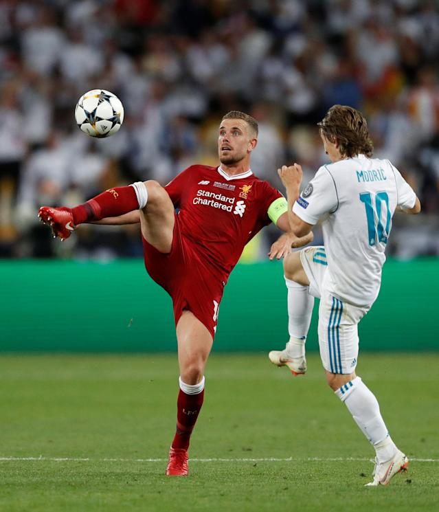 Soccer Football - Champions League Final - Real Madrid v Liverpool - NSC Olympic Stadium, Kiev, Ukraine - May 26, 2018 Liverpool's Jordan Henderson in action with Real Madrid's Luka Modric REUTERS/Andrew Boyers