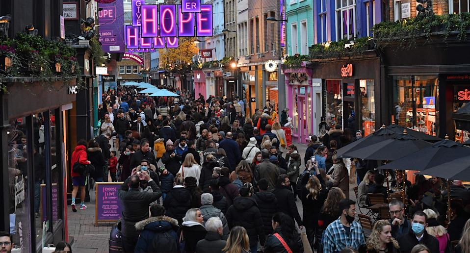 Shoppers and pedestrians are seen in Carnaby Street in London on December, as people take advantage of the easing of England's restrictions on shop openings to combat the spread of coronavirus.