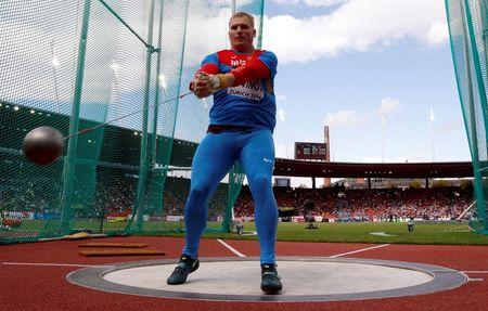 Litvinov of Russia competes in the men's hammer throw final during the European Athletics Championships at the Letzigrund Stadium in Zurich