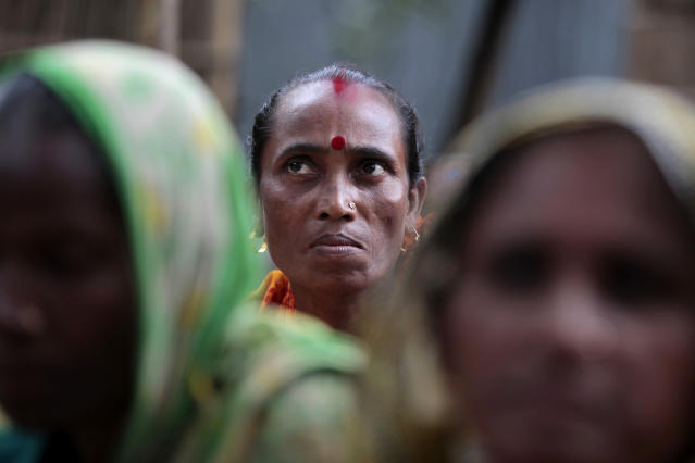 """In this Sept. 30, 2012, photo, Bangladeshi woman Shemoli Rani Das listens at their usual weekly meetings at Saghata, a remote impoverished farming village in Gaibandha district, 120 miles (192 kilometers) north of capital Dhaka, Bangladesh. Dozens of """"Info Ladies"""" bike into remote Bangladeshi villages with laptops and Internet connections, helping tens of thousands of people - especially women - get everything from government services to chats with distant loved ones. (AP Photo/A.M. Ahad)"""