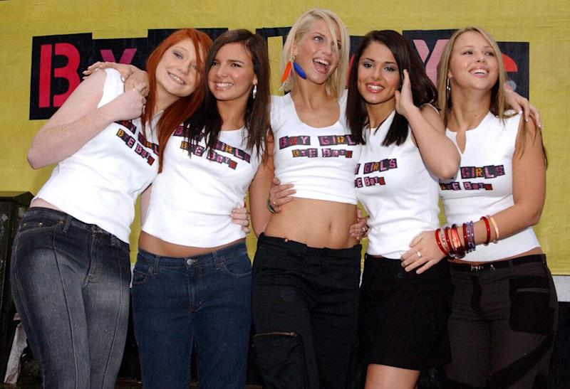 Popstars - The Rivals winners, Girls Aloud, from left to right; Nicola Roberts, 17, Nadine Coyle, 17, Sarah Harding, 20, Cheryl Tweedy, 19, and Kimberley Walsh, 20, pose for photographers in front of their poster in east London. * 11/01/03 Girls Aloud singer Cheryl Tweedy, 19, who was arrested, after an alleged attack in a nightclub, police said. Tweedy, with the all-girl group currently at number one in the charts, is accused of punching law student Sophie Amogbokpa, 39, who was working as a toilet attendant at a nightspot known as The Drink in Guildford, Surrey.