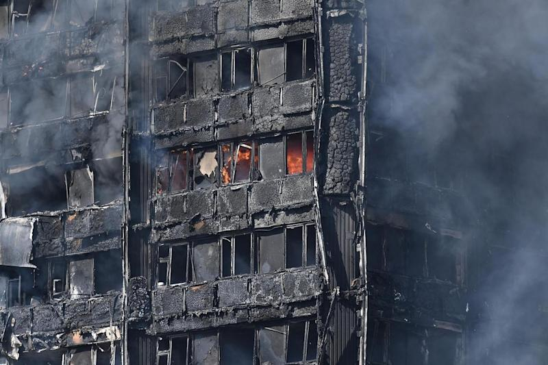 Fires continued to burn inside the building after 200 firefighters tackled the blaze on June 14, 2017. (Getty/Carl Court)
