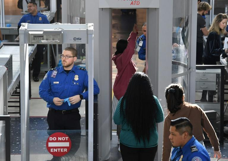 Transportation Security Administration officers work unpaid on the first day of the US government shutdown, at Los Angeles International Airport on December 22, 2018