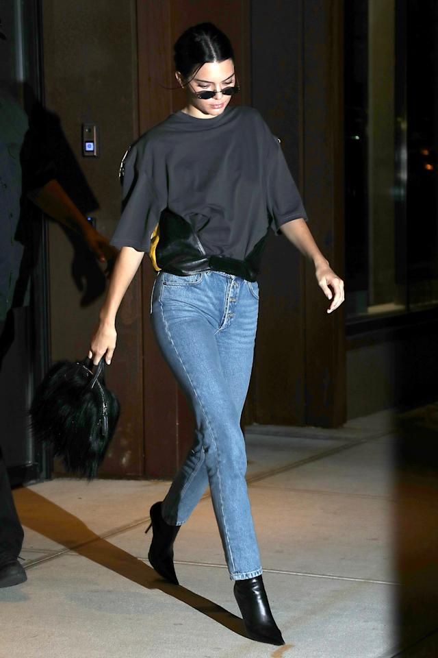 <p>In a Balenciaga t-shirt, jeans, and leather ankle boots with small sunglasses while out in New York City. </p>