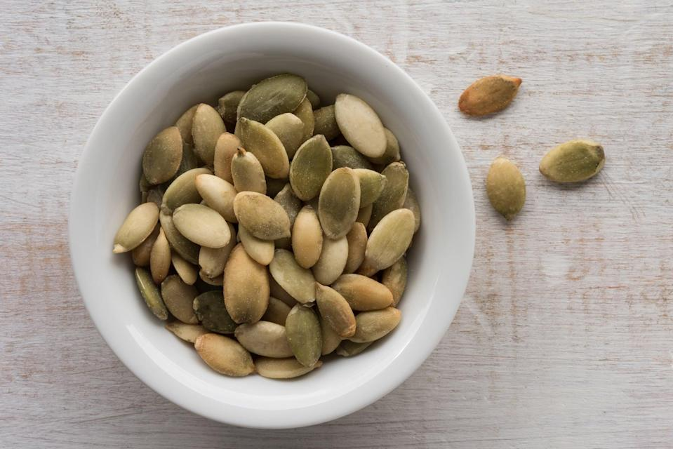 "<p>One ounce of pumpkin seeds delivers <a href=""https://fdc.nal.usda.gov/fdc-app.html#/food-details/170188/nutrients"" class=""link rapid-noclick-resp"" rel=""nofollow noopener"" target=""_blank"" data-ylk=""slk:74 milligrams of magnesium"">74 milligrams of magnesium</a>, making them a perfect bedtime snack to help you get some restful sleep.</p>"