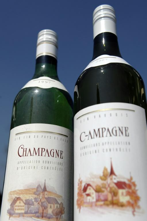 Bottles of wine from the Swiss village marked C-hampagne, because the town is not allowed to use its name on its wine