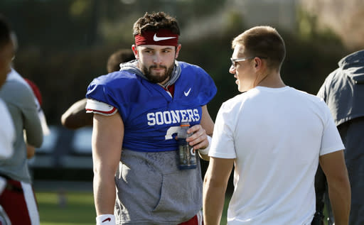 Oklahoma quarterback Baker Mayfield takes a breather after he participated in drills during a practice on Friday. (AP)