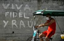 A poster in Havana reads 'Long Live Fidel and Raul' -- the brothers Castro who will for the first time in 60 years not be in power in Cuba