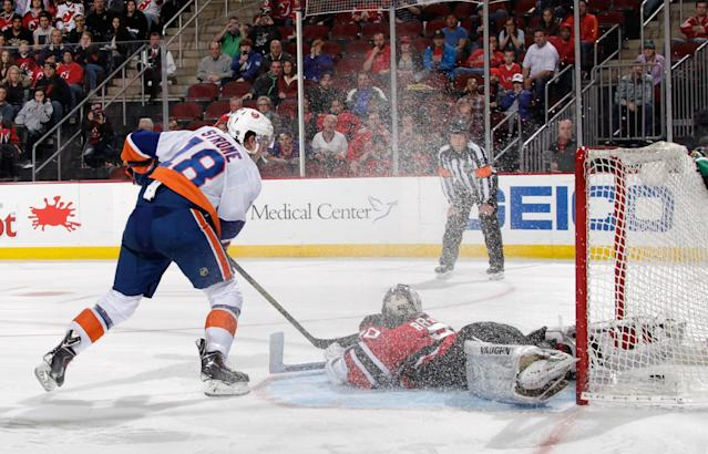 NEWARK, NJ - APRIL 11: Ryan Strome #18 of the New York Islanders of the New York Islanders scores on a spin-o-rama in the shootout against Martin Brodeur #30 of the New Jersey Devils at the Prudential Center on April 11, 2014 in Newark, New Jersey. The Islanders defeated the Devils 3-2 in the shootout. (Photo by Bruce Bennett/Getty Images)
