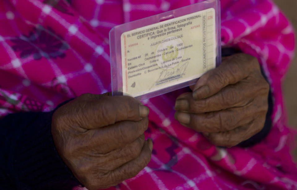 Ms Flores Colque holds her ID card displaying her date of birth (Picture: AP)