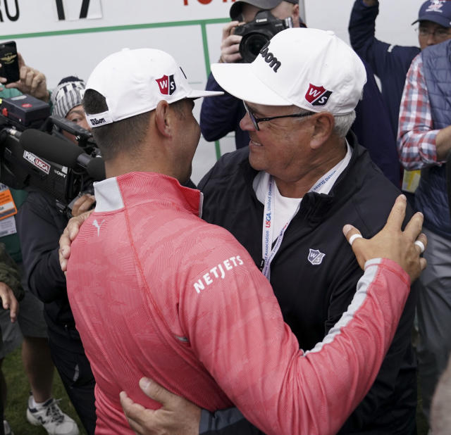 Gary Woodland celebrates after winning the U.S. Open Championship golf tournament with his father Dan, Sunday, June 16, 2019, in Pebble Beach, Calif. (AP Photo/Carolyn Kaster)